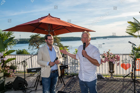 Stock Image of Johannes B. Kerner (R) and BILD Editor-in-Chief Julian Reichelt (L) attend the charity summer party 'Ein Herz fuer Kinder' (A Heart for Children) in Berlin, Germany, 24 June 2019 (issued 25 June 2019). The organization collected donations for children's charity organizations in Germany and the whole world.