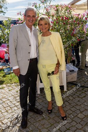 Stock Photo of Uschi Glas (L) and her husband Dieter Hermann arrive for the charity summer party 'Ein Herz fuer Kinder' (A Heart for Children) in Berlin, Germany, 24 June 2019 (issued 25 June 2019). The organization collected donations for children's charity organizations in Germany and the whole world.