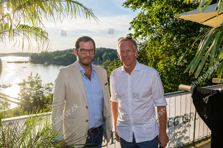 Johannes B. Kerner (R) and BILD Editor-in-Chief Julian Reichelt (L) attend the charity summer party 'Ein Herz fuer Kinder' (A Heart for Children) in Berlin, Germany, 24 June 2019. The organization collected donations for children's charity organizations in Germany and the whole world.