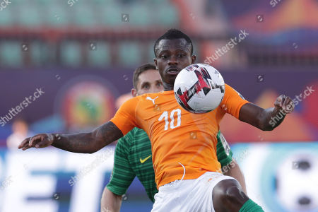 Ivory Coast's Jean Michael Seri controls the ball in front South Africa's Dean Furman during the African Cup of Nations group D soccer match between Ivory Coast and South Africa in Al Salam Stadium in Cairo, Egypt