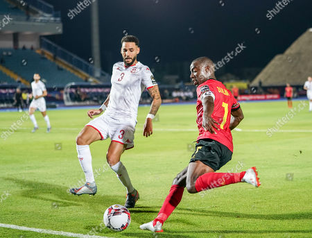 Djalma Braune Manuel Abel Campos of Angola passing the ball in front of Dylan Daniel Mahmoud Bronn of Tunisia during the African Cup of Nations match between Tunisia and Angola at the Suez Army stadium in Suez, Egypt