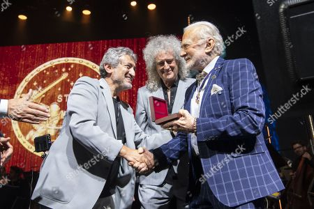 Astronaut Buzz Aldrin (R) receives the Lifetime Achievement Award of Stephen Hawking Medal for Science Communication from Garik Israelian, Starmus Founding Diector (L)and Musician Brian May during the official opening of the Starmus Festival 'Once Upon a Time on the Moon' in Zurich, Switzerland, 24 June 2019. The 2019 Starmus Festival celebrates mankind's first step on the Moon, coinciding with the 50th anniversary of this event in human history.