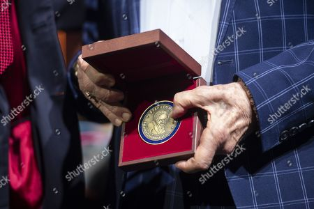 Astronaut Buzz Aldrin shows the medal after receives the Lifetime Achievement Award of Stephen Hawking Medal for Science Communication during the official opening of the Starmus Festival 'Once Upon a Time on the Moon' in Zurich, Switzerland, 24 June 2019. The 2019 Starmus Festival celebrates mankind's first step on the Moon, coinciding with the 50th anniversary of this event in human history.