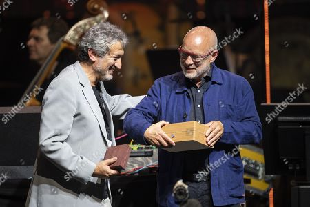 Stock Image of Brian Eno (R) receives the Stephen Hawking Medal for Science Communication from Starmus Founding Diector Garik Israelian (L) during the official opening of the Starmus Festival 'Once Upon a Time on the Moon' in Zurich, Switzerland, 24 June 2019. The 2019 Starmus Festival celebrates mankind's first step on the Moon, coinciding with the 50th anniversary of this event in human history.