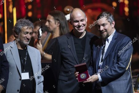 Producer Todd Douglas Miller (R) receives the Stephen Hawking Medal for Science Communication from Starmus Founding Diector Garik Israelian (L) during the official opening of the Starmus Festival 'Once Upon a Time on the Moon' in Zurich, Switzerland, 24 June 2019. The 2019 Starmus Festival celebrates mankind's first step on the Moon, coinciding with the 50th anniversary of this event in human history.