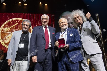 US Astronaut Buzz Aldrin (2-R) receives the Lifetime Achievement Award of Stephen Hawking Medal for Science Communication from Starmus Founding Diector Garik Israelian (L), British Musician Brian May (R) and philanthropist Michael Hintze (2-L) during the official opening of the Starmus Festival 'Once Upon a Time on the Moon' in Zurich, Switzerland, 24 June 2019. The 2019 Starmus Festival celebrates mankind's first step on the Moon, coinciding with the 50th anniversary of this event in human history.