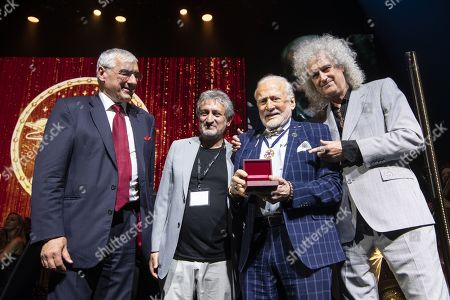 Stock Photo of US Astronaut Buzz Aldrin (2-R) receives the Lifetime Achievement Award of Stephen Hawking Medal for Science Communication from Starmus Founding Diector Garik Israelian (2-L), British Musician Brian May (R) and philanthropist Michael Hintze (L) during the official opening of the Starmus Festival 'Once Upon a Time on the Moon' in Zurich, Switzerland, 24 June 2019. The 2019 Starmus Festival celebrates mankind's first step on the Moon, coinciding with the 50th anniversary of this event in human history.