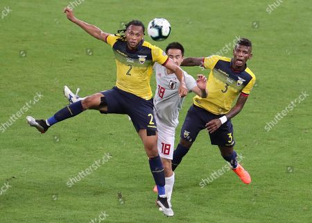 Ecuador's Arturo Mina, left, Japan's Shinji Okazaki, center, and Ecuador's Robert Arboleda fight for the ball during a Copa America Group C soccer match at the Mineirao stadium in Belo Horizonte, Brazil