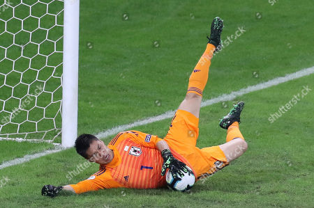 Japan's goalkeeper Eiji Kawashima stops the ball during a Copa America Group C soccer match against Ecuador at the Mineirao stadium in Belo Horizonte, Brazil