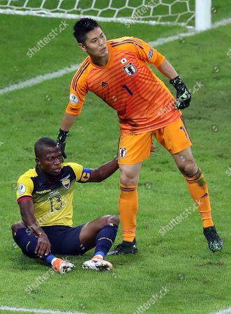 Japan's goalkeeper Eiji Kawashima and Ecuador's Enner Valencia acknowledge each other after Kawashima stopped his attack during a Copa America Group C soccer match at the Mineirao stadium in Belo Horizonte, Brazil