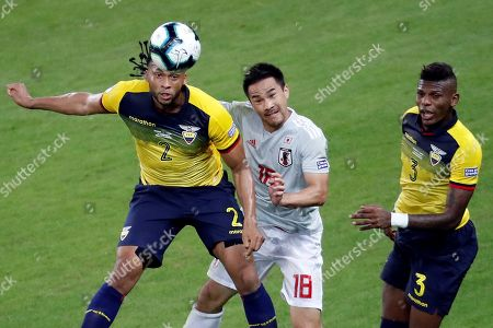 Arturo Mina (L) and Robert Arboleda (R) of Ecuador in action against Shinji Okazaki (C) of Japan during the Copa America 2019 Group C soccer match between Ecuador and Japan, at Mineirao Stadium in Belo Horizonte, Brazil, 24 June 2019.