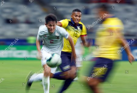 Antonio Valencia (C) of Ecuador in action against Daiki Sugioka (L) of Japan during the Copa America 2019 Group C soccer match between Ecuador and Japan, at Mineirao Stadium in Belo Horizonte, Brazil, 24 June 2019.