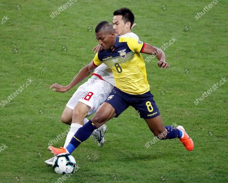 Ecuador's Gruezo (R) vies for the ball with Japan's Shinji Okazaki during the Copa America 2019 Group C soccer match between Ecuador and Japan, at Mineirao Stadium in Belo Horizonte, Brazil, 24 June 2019.