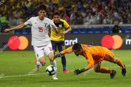 Stock Picture of Japan's goalkeeper Eiji Kawashima, right, jumps for the ball as Japan's Daiki Suga, left, and Ecuador's Angel Mena, center, look on during a Copa America Group C soccer match at the Mineirao stadium in Belo Horizonte, Brazil