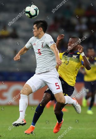 Japan's Naomichi Ueda, left, heads the ball next to Ecuador's Enner Valencia during a Copa America Group C soccer match at the Mineirao stadium in Belo Horizonte, Brazil