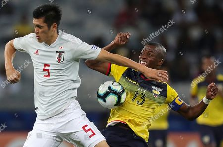 Japan's Naomichi Ueda, left, jumps for the ball with Ecuador's Enner Valencia during a Copa America Group C soccer match at the Mineirao stadium in Belo Horizonte, Brazil