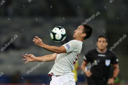 Stock Photo of Japan's Shinji Okazaki controls the ball during a Copa America Group C soccer match against Ecuador at the Mineirao stadium in Belo Horizonte, Brazil
