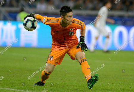Japan's goalkeeper Eiji Kawashima passes the ball during a Copa America Group C soccer match against Ecuador at Mineirao stadium in Belo Horizonte, Brazil
