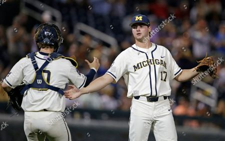 Michigan pitcher Jeff Criswell (17) is congratulated by Michigan catcher Joe Donovan (0) after Michigan defeated Vanderbilt in Game 1 of the NCAA College World Series baseball finals in Omaha, Neb