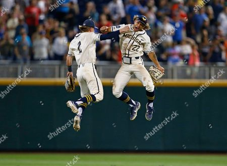 Michigan right fielder Jordan Brewer (22) celebrates with Michigan shortstop Jack Blomgren (2) after Michigan defeated Vanderbilt in Game 1 of the NCAA College World Series baseball finals in Omaha, Neb