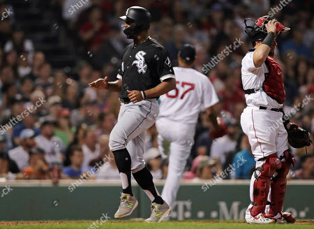 Yoan Moncado, Christian Vazquez, Eduardo Rodriguez. Chicago White Sox's Yoan Moncada, left, scores on a single by Yolmer Sanchez during the seventh inning of a baseball game against the Boston Red Sox at Fenway Park in Boston, . Red Sox catcher Christian Vazquez, right, and pitcher Eduardo Rodriguez (57) look on