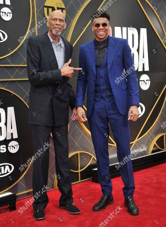 Kareem Abdul Jabbar, Giannis Antetokounmpo. Kareem Abdul Jabbar, left, and NBA player Giannis Antetokounmpo, of the Milwaukee Bucks, arrives at the NBA Awards, at the Barker Hangar in Santa Monica, Calif