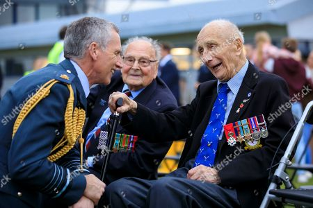 Stock Photo of Air Chief Marshal Sir Stephen Hillier, Chief of the Air Staff chats to WWII Bomber Command veterans Chick Chandler and George Dunn DFC at an event at RAF Odiham to mark the centenary of the Royal Air Force Benevolent Fund. The event, launched the charity's major new campaign to double the number of people they support. It saw 1,000+ RAF Family members come together to form the radar to highlight the Fund's drive to get the public to Join the Search. Change a Life