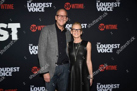 """John Heilemann, Diana Rhoten. John Heilemann, left, and wife Diana Rhoten attend the premiere of the ShowTime limited series """"The Loudest Voice"""" at the Paris Theatre, in New York"""