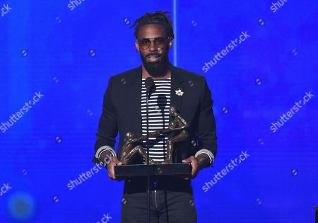 NBA player Mike Conley., of the Memphis Grizzlies, accepts the NBA teammates/sportsmanship of the year award at the NBA Awards, at the Barker Hangar in Santa Monica, Calif