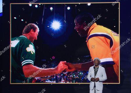 Stock Image of Samuel L. Jackson presents the lifetime achievement award at the NBA Awards, at the Barker Hangar in Santa Monica, Calif. Larry Bird, left, and Magic Johnson appear onscreen