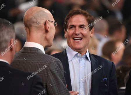 Adam Silver, Mark Cuban. NBA Commissioner Adam Silver, left, and Mark Cuban, governor of the NBA's Dallas Mavericks, speak in the audience at the NBA Awards, at the Barker Hangar in Santa Monica, Calif