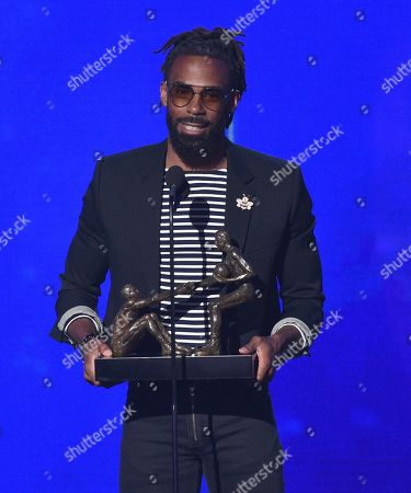 Stock Picture of NBA player Mike Conley., of the Memphis Grizzlies, accepts the NBA teammates/sportsmanship of the year award at the NBA Awards, at the Barker Hangar in Santa Monica, Calif