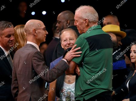 Adam Silver, Bill Walton. NBA Commissioner Adam Silver, left, and Bill Walton speak in the audience at the NBA Awards, at the Barker Hangar in Santa Monica, Calif