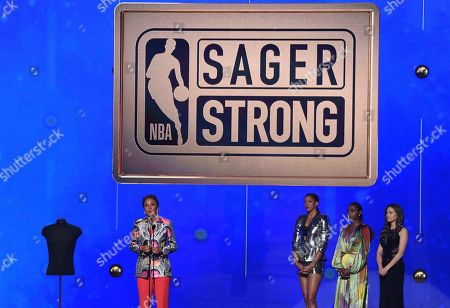 Robin Roberts, Candace Parker, Issa Rae. Robin Roberts accepts the Sager strong award at the NBA Awards, at the Barker Hangar in Santa Monica, Calif. Looking on from second right are Issa Rae and Candace Parker