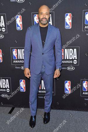 Jeffrey Wright poses in the press room at the NBA Awards, at the Barker Hangar in Santa Monica, Calif