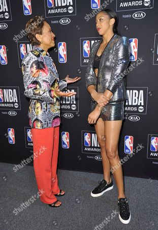 Stock Image of Robin Roberts, Candace Parker. Robin Roberts, recipient of the Sager strong award, left, and WNBA player Candace Parker, of the Los Angeles Sparks, speak in the press room at the NBA Awards, at the Barker Hangar in Santa Monica, Calif