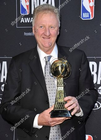 Stock Picture of Larry Bird poses in the press room with the lifetime achievement award at the NBA Awards, at the Barker Hangar in Santa Monica, Calif