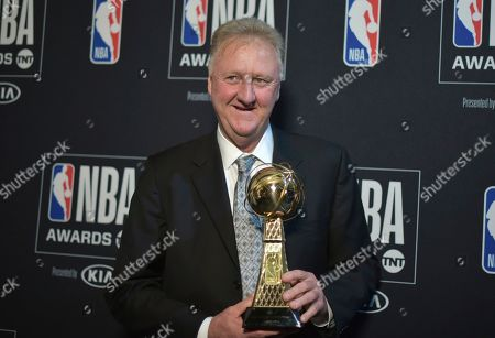 Larry Bird poses in the press room with the lifetime achievement award at the NBA Awards, at the Barker Hangar in Santa Monica, Calif