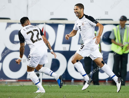 Costa Rica's Ronald Matarrita (L) and Alvaro Saborio (R) celebrate a goal, which was recorded as an own goal, during the first half of the CONCACAF Gold Cup group stage soccer match between Haiti and Costa Rica at Red Bull Stadium in Harrison, New Jersey, USA, 24 June 2019.