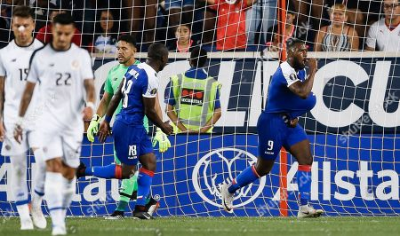 Stock Image of Haiti's Duckens Nazon (R) celebrates scoring a goal on a penalty kick with teammate Jonel Desire (2-R) as Costa Rica's Francisco Calvo (L), Ronald Matarrita and goalkeeper Leonel Moreira react during the second half of the CONCACAF Gold Cup group stage soccer match between Haiti and Costa Rica at Red Bull Stadium in Harrison, New Jersey, USA, 24 June 2019.