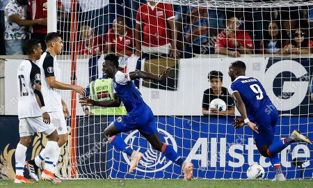 Haiti's Djimy Alexis (2-R) celebrates scoring a goal with teammate Duckens Nazon (R) as Costa Rica's Allan Cruz (L) and Celso Borges (2-L) look on during the second half of the CONCACAF Gold Cup group stage soccer match between Haiti and Costa Rica at Red Bull Stadium in Harrison, New Jersey, USA, 24 June 2019.