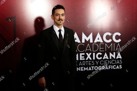 Stock Photo of Mexican actor Luis Gerardo Mendez poses during red carpet arrivals for the 61st edition of the Ariel Awards from the Mexican Academy of Arts and Cinematographic Sciences at the National Cineteca in Mexico City