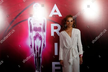 Stock Picture of Mexican actress Marina de Tavira poses during red carpet arrivals for the 61st edition of the Ariel Awards hosted by the Mexican Academy of Arts and Cinematographic Sciences at the National Cineteca in Mexico City