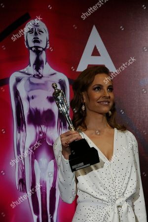 """Mexican actress Marina de Tavira poses with her award for best supporting actress for """"Roma"""" at the 61st edition of the Ariel Awards from the Mexican Academy of Arts and Cinematographic Sciences at the National Cineteca in Mexico City"""