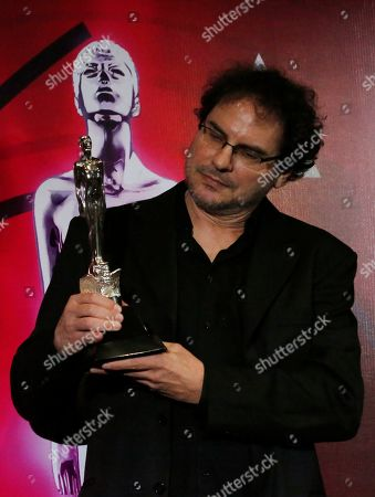 "Carlos Cuaron accepts his brother Alfonso Cuaron's award for Best Photography for ""Roma"" during the 61st edition of the Ariel Awards from the Mexican Academy of Arts and Cinematographic Sciences at the National Cineteca in Mexico City"