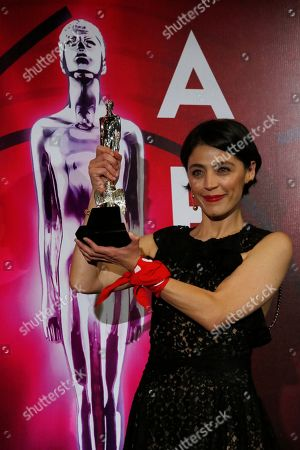 """Mexican actress Ilse Salas poses with her statue for Best Actress for """"Las ninas bien"""" during 61st edition of the Ariel Awards from the Mexican Academy of Arts and Cinematographic Sciences at the National Cineteca in Mexico City"""