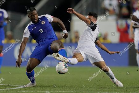 Haiti forward Duckens Nazon (9) and Costa Rica defender Giancarlo Gonzalez compete for possession during the first half of a CONCACAF Gold Cup soccer match, in Harrison, N.J