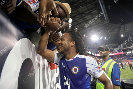 Haiti midfielder Herold Jr. Charles visits with fans after a CONCACAF Gold Cup soccer match against Costa Rica, in Harrison, N.J