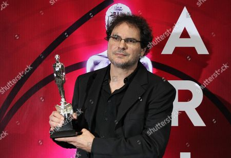 Carlos Cuaron poses with an award on the red carpet of the 61st Ariel Awards of the Mexican Academy of the Cinematographic Arts and Sciences (AMACC) at the National Firm Archive in Mexico City, Mexico, 24 June 2019.