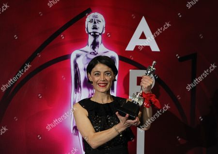 Stock Photo of Ilse Salas poses with an award on the red carpet of the 61st Ariel Awards of the Mexican Academy of the Cinematographic Arts and Sciences (AMACC) at the National Firm Archive in Mexico City, Mexico, 24 June 2019.
